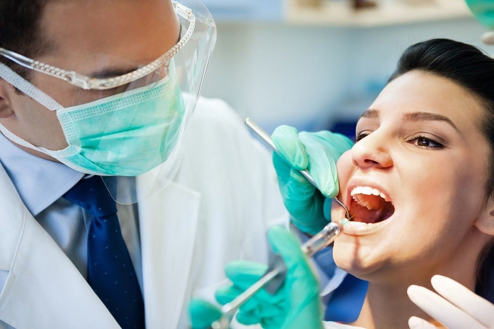 tooth extraction with oral surgeon